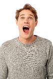 Zadziwiający młody facet z otwartym usta obraz royalty free