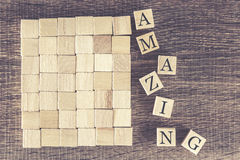 Zadziwiający słowo tworzący z drewnianymi blokami Obrazy Stock