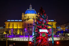 Zagreb Art Pavilion with decorated red Christmas tree, Croatia. Zagreb Art Pavilion with decorated red Christmas tree as part of Advent in Zagreb festivities Stock Photography