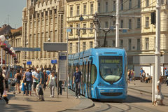 Zagreb central city square and tram stop. People walk along Ban Jelacic Square, the central square of the city, and tram stop in Zagreb, Croatia Stock Images