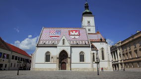 Zagreb city center. ZAGREB, CROATIA - May 5 2012: Pan shoot from Croatian Parliament building to the St. Mark church while tourist sightseeing and photographing stock video footage