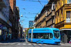 Zagreb city street. City street with old houses and passengers travel by   the modern famous blue  tram in Zagreb, Croatia Royalty Free Stock Photography