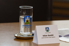 Zagreb, CROATIA – April 3, 2017: city insignia and glasses at Milan Bandic, mayor of Zagreb, in a press conference Stock Photography