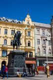 Locals and tourists at Zagreb main square next to the Statue of Count Ban Josip Jelacic stock image