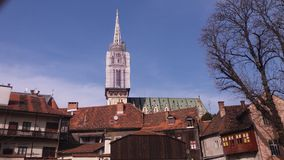 Zagreb, Croatia. City center, view on the church. Th Croatian architecture. Roofs of houses, Croatian tiled houses/ Zagreb Streets stock photo