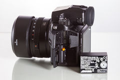 28. 05. 2017, Zagreb, CROATIA: Fujifilm GFX 50S, 51 megapixels,. Fujifilm GFX 50S, 51 megapixels, medium format sensor digital camera with battery on white Stock Photography
