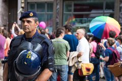 15th Zagreb pride. Intervention policeman in front of LGBTIQ activists on Ban Josip Jelacic square. ZAGREB, CROATIA - JUNE 11, 2016: 15th Zagreb pride royalty free stock photo