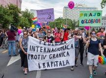 15th Zagreb pride. LGBTIQ activists holding pride banner. ZAGREB, CROATIA - JUNE 11, 2016: 15th Zagreb pride. LGBTIQ activists holding pride banner stock photography
