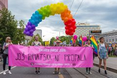 15th Zagreb pride. LGBTIQ activists holding pride banner. ZAGREB, CROATIA - JUNE 11, 2016: 15th Zagreb pride. LGBTIQ activists holding pride banner stock image