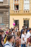 15th Zagreb pride. LGBTIQ activists on street. ZAGREB, CROATIA - JUNE 11, 2016: 15th Zagreb pride. Elderly woman watching LGBTIQ activists from her window royalty free stock images