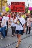 15th Zagreb pride. LGBTIQ activist holding banner. ZAGREB, CROATIA - JUNE 11, 2016: 15th Zagreb pride. LGBTIQ activist holding banner royalty free stock photography