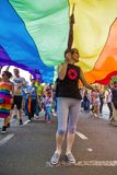 15th Zagreb pride. LGBTIQ activist under big rainbow flag. ZAGREB, CROATIA - JUNE 11, 2016: 15th Zagreb pride. LGBTIQ activist under big rainbow flag stock image