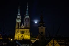 Zagreb, Croatia - March 2019: Cathedral and full moon by light installation at Festival of light in medieval part of Zagreb city. In beautiful night view to royalty free stock photos