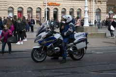 Policeman on motorcycle royalty free stock photography