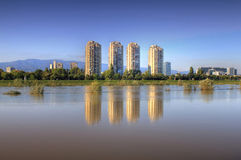 Zagreb on the river Sava. Residential buildings in croatian capital Zagreb, and reflections on river Sava when water level was high Royalty Free Stock Photography