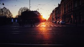 Zagreb Starcevic Square. ZAGREB, CROATIA - March 18, 2016: Pedestrians crossing the road at the crosswalk on the Ante Starcevic square at sunset, Croatian stock video