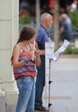 Zagreb Street Musician / Girl Playing Flute royalty free stock photo