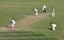 Zahir Khan's follow through in a Cricket Match Stock Images
