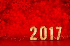 Zahl des guten Rutsch ins Neue Jahr 2017 an roten funkelnden bokeh Lichtern, Urlaub s Lizenzfreies Stockbild