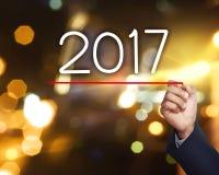 Zahl des Handabgehobenen betrages 2017 Stockbilder
