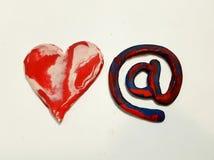 Zahl des Herzens und am Symbol mit Mischung von Plasticinefarben Lizenzfreie Stockfotografie