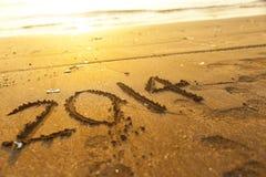Zahl des neuen Jahres 2014 auf Sand Stockfoto