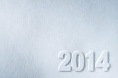 Zahl des neuen Jahres 2014 auf Schneehintergrund Stockbild
