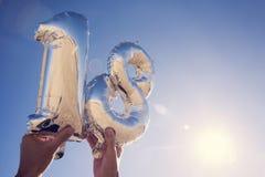 Zahl-förmige Ballone, welche die Nr. 18 bilden Lizenzfreies Stockbild