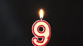 Zahl neun Kerze 4K brennend stock video footage