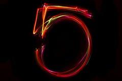 Zahl ` 5 ` Schreiben vom Licht Stockfotos