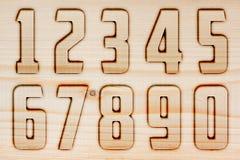 Zahlen auf Holz Stockfoto