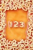Zahlen eine, zwei und drei in der Tomate-Teigwaren-Soße Lizenzfreie Stockbilder