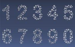 Zahlen gemacht durch Schneeflocken Lizenzfreie Stockfotos