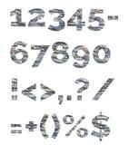 Zahlen und Symbole werden aus dekorativen Steinen verfasst Alphabet von den Steinbuchstaben Lizenzfreie Stockfotografie
