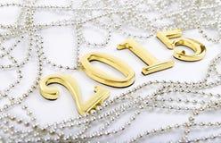 Zahlen von dem neuen 2015-jährigen auf einem weißen Hintergrund Stockbild