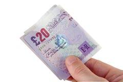 Zahlung in den Pounds lizenzfreie stockbilder