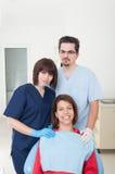 Zahnarztfrau, -assistent und -patient Lizenzfreie Stockbilder