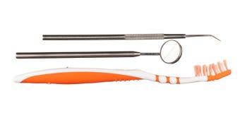 Zahnbürste und zahnmedizinische Instrumente lizenzfreie stockfotografie