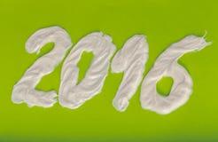 Zahnpasta in Form von Nr. 2016 auf der Grünbuchrückseite Lizenzfreie Stockfotografie