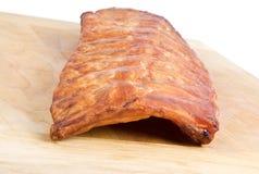 Zahnstange der geräucherten Schweinefleisch-Rippe Stockfotos