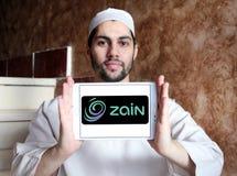 Zain telecommunications company logo. Logo of Zain telecommunications company on samsung tablet holded by arab muslim man. it is a mobile telecommunications Royalty Free Stock Image