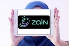 Zain telecommunications company logo. Logo of Zain telecommunications company on samsung tablet holded by arab muslim woman. it is a mobile telecommunications Stock Image