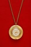Zak gouden horloge met ketting stock afbeelding