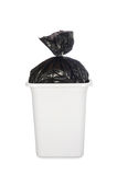 Zak huisvuil in vuilnisbak Stock Foto's