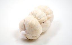 Zak knoflook dat op wit wordt geïsoleerdl Stock Fotografie