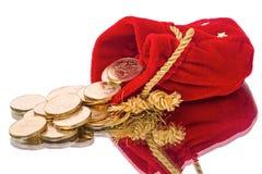 Zak met muntstukken op een spiegel Royalty-vrije Stock Fotografie