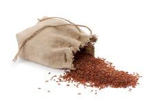 Zak met rode rijst Stock Fotografie