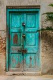 Zakłopotany Turkusowy drzwi Zdjęcia Stock
