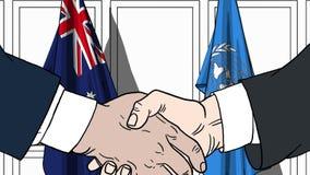 Zakenlieden of politicischokhanden tegen vlaggen van Australië en de Verenigde Naties Officiële vergadering of samenwerking royalty-vrije illustratie