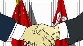 Zakenlieden of politicischokhanden tegen vlaggen van China en Hong Kong Officiële verwante vergadering of samenwerking stock illustratie